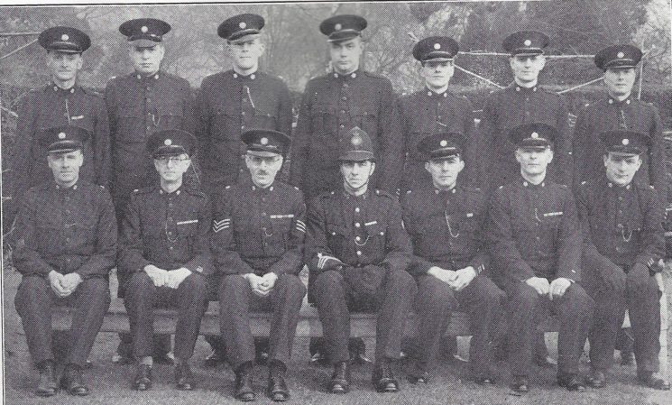 Storud Division Cainscross Subsection. Back Row: Special Constables Daniels, Watson, Cullimore, Bird, Garraway, Bullock, Preece. Seated: Special Constables Cook, Thompson, Special Sergeant Lambert, Police Constable levell, Head Special Constable Clark, Special Constables Lugg, Davis. (Gloucestershire Police Archives URN 6993)