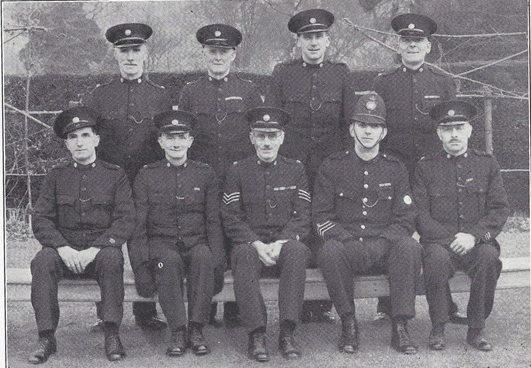 Stroud Division Chalford Section. Back Row: Special Constables Peacey, Taylor, Hook, Dalby. Seated: Special Constables Griffin, Freeman, Special Sergeant Lambert, Police Constable Baily, Head Special Constable Mallinson. (Gloucestershire Police Archives URN 6994)