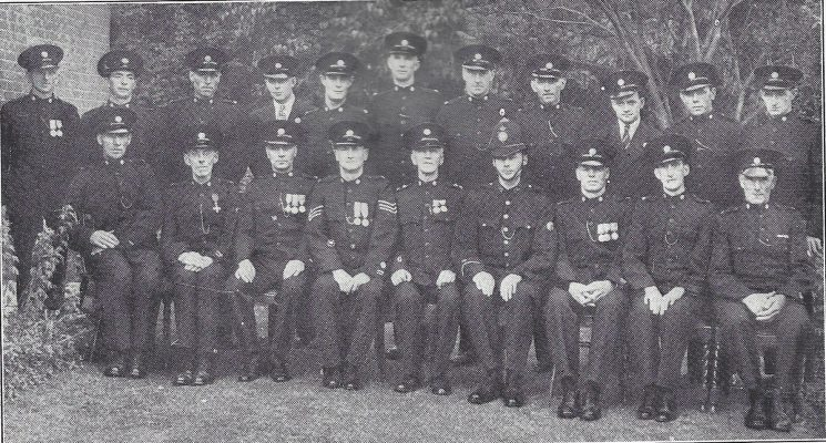 Gloucester Rural Division Ashleworth Section. Back row: Special Constables Jelf, Franklin, Finch, Bartlett, Hiam, Price, Blace, Marmon, Corn, Hale, Cole. Seated: Special Constable Chamberlain, Head Special Constables Driver, Ballard, Special Sergeant Gay, Special inspector Gillespy, Police Constable Davies, Head Special Constable Watts, Special Constables Powell, Woodward. (Gloucestershire Police Archives URN 6995)