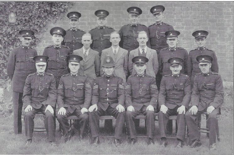 Gloucester Urban Division Barnwood Section. Back row: Special Constables Cambridge, Curtis, Pepperell, Stangroom. Middle row: Special Constables Parkinson, Toomey, Clifford, McClelland, Robb, Guest, Ireland. Seated: Special Constable Tipping, Special Sergeant  West, Police Constable Vickers, Special Sergeant Hardy, Special Constables Davis, Merrett (Gloucestershire Police Archives URN 6996)