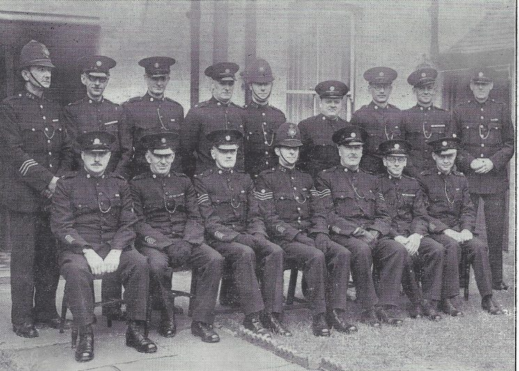Gloucester Urban Division Bristol Road Section. Back row: Police Constable Batchelor, Special Constables Moreland, Davenport, Sharpe, Hiron, Smith, Roberts, Evans, Bewick. Seated: Special Constables Barber, Lacey, Special Sergeant Morris, Police Sergeant Tibbles, Special Sergeant Allen, Head Special Constable King, Special Constable Pearce. (Gloucestershire Police Archives URN 6999)