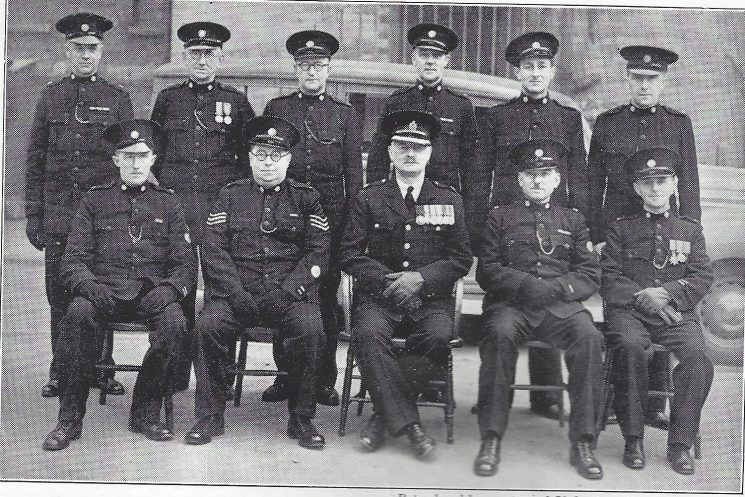 Cheltenham Urban Division Cheltenham Central Mobile Section. Back row: Special Constables Gooch, O'Niell, Murphy, Dangerfield, Heathfield, Dennis. Seated: Special Constables James, Dodwell, Superintendent Hopkins , Special Constables Tandy, Oates. (Gloucestershire Police Archives URN 7001)