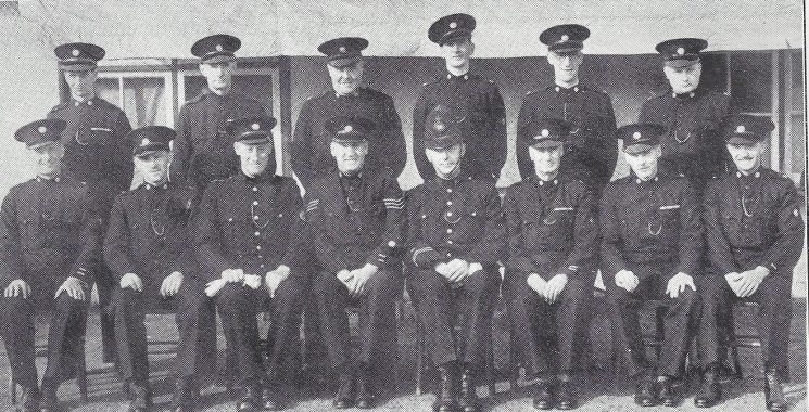 Gloucester Rural Division Cheltenham Road Section. Back row: Special Constables Gurney, Smith, Rushton, Twissell, Ridgeon, Bartrip. Seated: Special Constables Green, Cocks, Police War Reserve Winnington, Special Sergeant Graham, Police Constable Westcott, Special Sergeant Moss,(Gloucestershire Police Archives URN 7004)