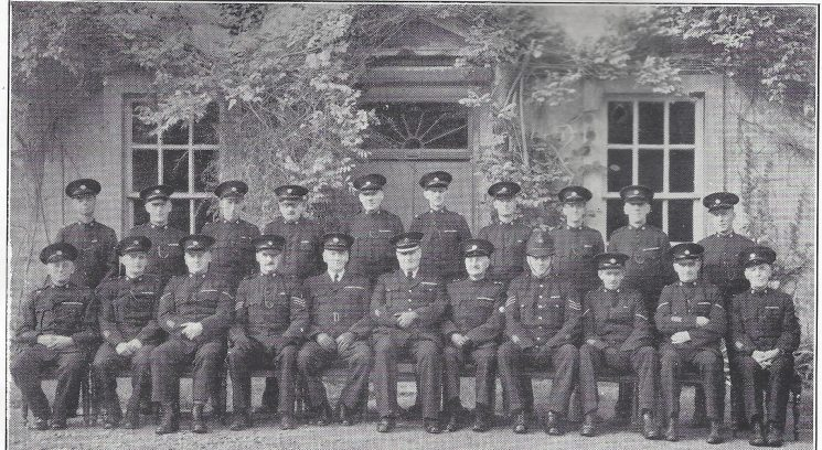 Stroud Division Kings Stanley, Leonard Stanley and Frocester Sections. Back row: Special Constables Perry, Eaton, Jenner, Priestley, Wathen, Lawrence, Casson, Patrick, Howell, Chudleigh. Seated: Special Constables Howard, Weakford, Head Special Constable Pullin, Special Sergeant Curtis-Hayward, Special Superintendent Limbrick, Superintendent Williams, Special Inspector Bendall, Police Sergeant Webber, Head Special Constables Price, King, Special Constable Smith R. (Gloucestershire Police Archives URN 7015)