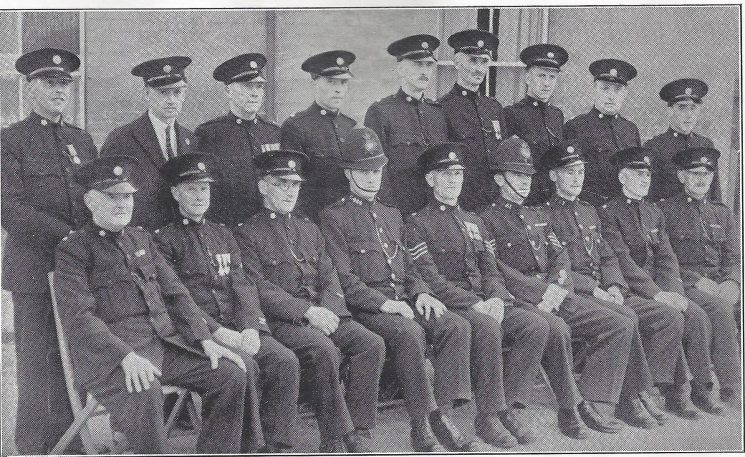 Gloucester Rural Division Longford Section. Back row: Special Sergeant Humphries, Special Constables, Clissold, Savage, Lawrence, Plummer, Collier, Lloyd, Holford, Bendle. Seated: Special Constables Cuff, Roberts, Jordan, Police constable Tucker, Special Sergeant Turner, Police Sergeant Lewis, Police War Reserve Toombs, Special Constables Hughes, Sampson.(Gloucestershire Police Archives URN 7016)