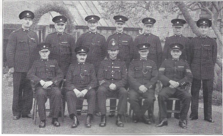 Stroud Division Minchinhampton Section. Back Row: Special Constables Taylor, Smith F.T, Smith H.F, Newman, Milsom, White, Burge. Seated: Special Constables Kirby, Lait, Police Constable Buckle, Head Special Constable Mortimer, Special Sergeant Harris (Gloucestershire Police Archives URN 7019)