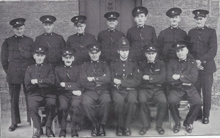 Forest of Dean Division Mitcheldean Section. Back row: Special Constables Betteridge, Jackson, Hale, Baldwin, Newman, Clarke, Smith. Seated: Special Constables Vincent, little, Head Special Constable Bullock, Police Constable Buckland, Special Constables Ellis, Cottrell.(Gloucestershire Police Archives URN 7021)