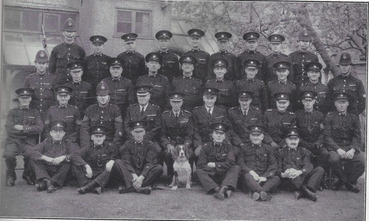 Stroud Division Nailsworth Section. Back row: Police Constable Townsend, Special Constables Luckett, Ayres, Hatherhall, Newman, White, Cooper, Kimbrey, Police Constable Brotheridge. Middle row: Police Constable Buckle, Special Constables Kirby, Smith F.T, Taylor, Smith H, Burge, Milsom, Smith W.C, Wheeler Police Constable Hogg. Seated: Special Constable Mortimer, Special Sergeant Harris, Police Sergeant Miles, Superintendent Williams, Commandant Sleeman, Special Superintendent Limbrick, Special Superintendent Jessop, Special Inspector Bendall, Special Sergeant Hender, Special Constable Luscott. Front row: Special Constables Harvey, Allchorn, Wright, May, Franklin, Lait. (Gloucestershire Police Archives URN 7022)