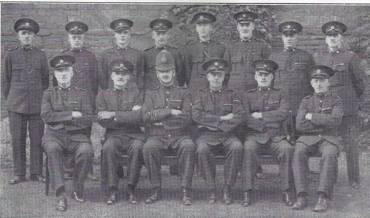 Forest of Dean Division Newnham Section. Back row: Special Constables Ferris, Rymer, James, Hooper, Cox, Hodgson, Grimmett, Lloyd. Seated: Special Constables Lowes, Harrison, Police Constable James, Head Special Constable Blanton, Special Constable Atkins, Police War Reserve Rawlins.(Gloucestershire Police Archives URN 7024)