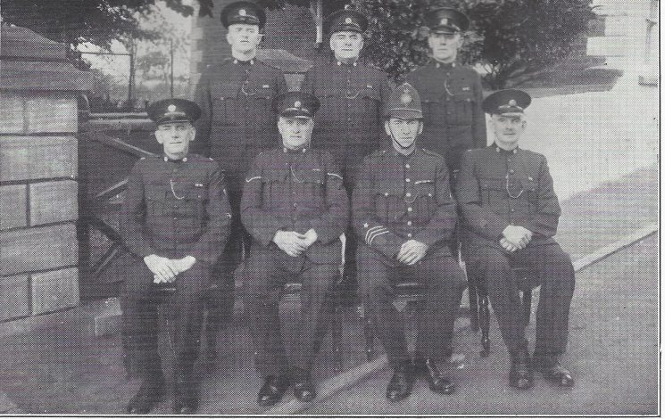 Forest of Dean Division Ruardean Section. Back row: Special Constables Knight, Marfell, Vaughan. Seated: Special Constable Dunkley, Head Special Constable Scott, Police Constable Boughton, Special Constable Beard. (Gloucestershire Police Archives URN 7029)