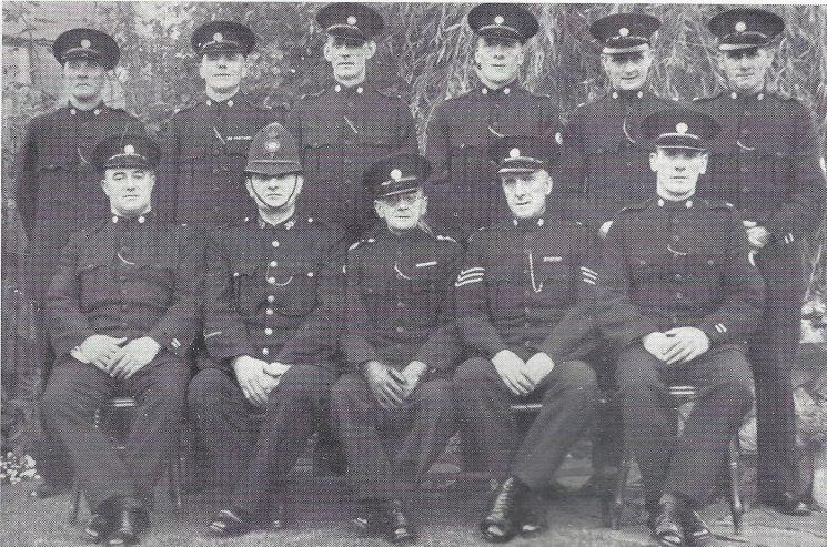 Forest of Dean Division Ruspidge Section. Back row: Special Constables Shermer, Warren, Edwards, Middlecote, Pritchard, Bowdler. Seated: Head Special Constable Walkley, Police Constable Taylor, Special Inspector James, Special Sergeant Ellis, Special Constable Godwin. (Gloucestershire Police Archives URN 7030)