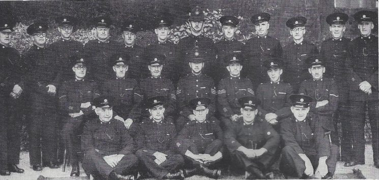 Cheltenham Urban Division  St Marks Section. Back row: Special Constables Fluck, Gunstone, Smith L, Crocker, Cook, Challenger, Police Constable Roebuck, Special Constables Green, Dyer, Greenbank, Harvey, Wood. Middle row: Head Special Constables Vizor, Corbett, Special Sergeant Harford, Police Sergeant Lewis, Special Sergeant Cummins, Special Constable Abbott, Head Special Constable Vincent. Front row: Special Constables Hewett, James, Sparrow, Scott, McCabe. (Gloucestershire Police Archives URN 7033)