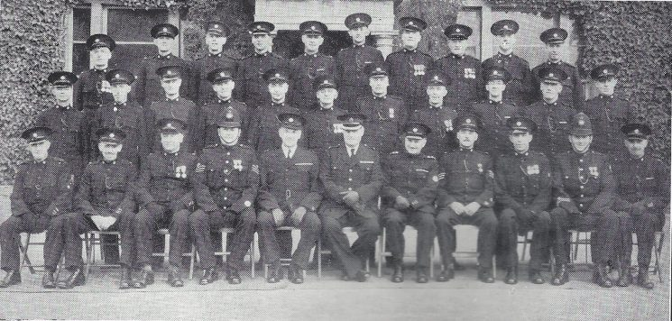 Stroud Division Stonehouse and King Stanley Section. Back row: Special Constables Smith C.R, Lawrence, Howell, Axford, Troughton, Lawrence, Long, West, Price, Shurman. Middle row: Special Constables Perry, Jenner, Casson, Hack, Lee, Howard, Blick, Chudleigh, Patrick, Wager, Soule. Seated: Head Special Constables Prout, Price, Pullin, Police Sergeant Iles, Special Superintendent Limbrick, Superintendent Williams, Special Inspector Bendall, Special Sergeant Curtis Hayward, Head Special Constable Pollard, Police Constable Webber, Head Special Constable King. (Gloucestershire Police Archives URN 7034)