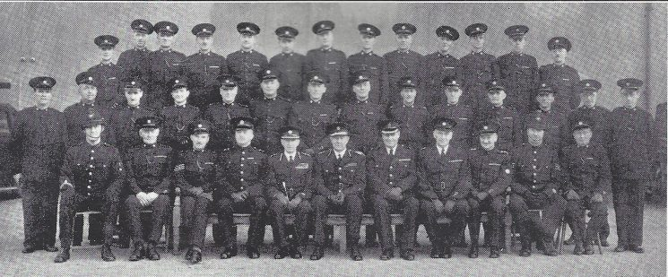 Stroud Division Stroud, Summer Street and Slad Sections. Back row: Special Constables Kerry, Askew, Cleaveley, Stafford, Smith W.J, Watson, Paul, Busson, Tilley, Gay, Cooke, Vick, Edmunds. Middle row: Special Constabales Phelps, Pearce, Pyne, Angus, Mauler, Smith W.B, Horton, Goulding, Gardner, Weakford, Skinner, Cooper, Tarrant. Seated: Police Constable Mills, Special Constable Tomlinson, special Sergeant Waterman, Inspector Herbert, Commandant Sleeman, Chief Constable Henn, Superintendent Williams, Special Superintendent Limbrick, Special Inspector Bendall, Police Sergeant Crowther, Head Special Constable Stephens (Gloucestershire Police Archives URN 7035)