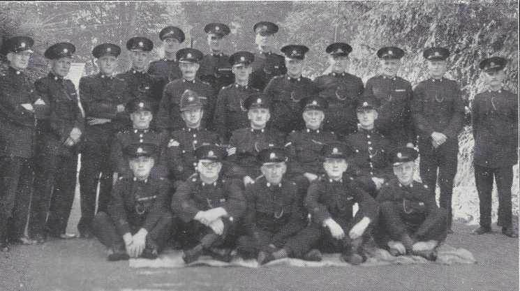 Forest of Dean Division Tutshill Section. Back row: Special Constables Williams, Tandy, Reeks, King, Foster, Riley, Flowers. Second row: Special Constables Randle, Simmonds, Ogree, Grier, Clark, Corne, Lewis. Third row: Police War Reserve King, Police Sergeant Morris, Special Sergeant Shirley, Head Special Constable Ball, Police War Reserve Verrier. Front row: Special Constables Wood, Manson, Blandford, Beddoe, Jones.(Gloucestershire Police Archives URN 7036)