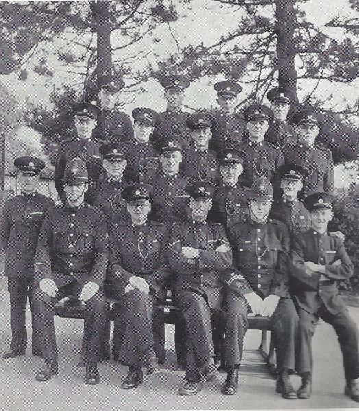 Forest of Dean Division  Yorkley Section. Back row: Special Constables Gunter H, Robins, Brown, Beddis B. Second row: Special Constables Jones, Craddock, Morse, Beddis R, Jones. Third row: Special Constables Wilce, Fletcher,  Gunter C, Ames, Price. Seated: Police Constable Emerson, Special Constable Lewis E, Head Special Constable Jones, Police Constable Fardon, Special Constable Lewis S. (Gloucestershire Police Archives URN 7039)