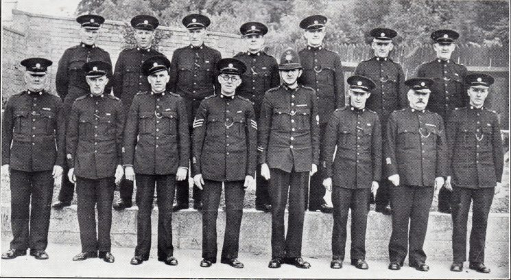 Forest of Dean Division Blakeney Section. Back row: Special Constables Miles, Penn, Lane, Turner, Porter, Saint, Tirley. Front row: Special Constables Biddington, Hammond, Screen, Special Sergeant Wayman, Police Constable Large, Special Constables Biddington, Bleaken. (Gloucestershire Police Archives URN 7042)