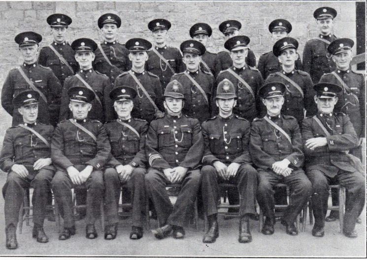 Forest of Dean Division Bream Section. Back row: Special Constables Morse, Ellway, Windsor, Haddock, Parr, Reader, Robinson. Middle row: Special Constables Lewis W, Cooper, Meek, Lewis B, Edmunds A, Hill, Hancocks. Seated: Special Constables Horsley, Thomas, Head Special Constable Burdess, Police Constables Weekes, Brown, Special Constables James, Edmunds E. (Gloucestershire Police Archives URN 7044)
