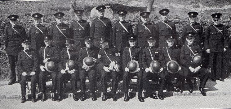 Moreton in Marsh Division Mickleton Section. Back row: Special Constables Jones G, Righton, Head Special Constable  Chadband, Special Constables Brain, Lester, Bennett, Williams, Baker, Rendell, Tidmarsh. Seated: Special Constable Everard, Special Sergeant Bayliss, Special Constables Wilks, Jones A, Special Sergeant Hubbard, Special Constables Tuffley, Bowell, Massey, Head Special Constable Courtman. (Gloucestershire Police Archives URN 7038)
