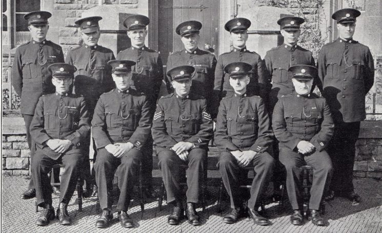 Moreton in Marsh Division Moreton in Marsh Mobile Section. Back row: Special Constables Page, Dyde, Randall, Green, Lewis, Gillett, Currill. Seated: Special Constable Beddoes, Head Special Constable Dyer, Special Sergeant Welland, Head Special Constable Aldred, Special Constable Price. (Gloucestershire Police Archives URN 7047)