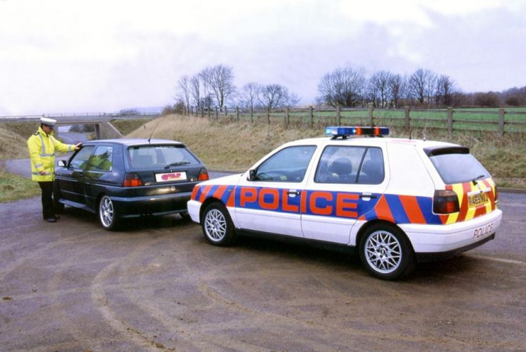 Just off the A417 at Barrow Wake with Police Constable Ian Batham. This was a photo shoot for a Volkswagen magazine. 1997. (Gloucestershire Police Archives URN 7830) | Photograph from Alan Matthews