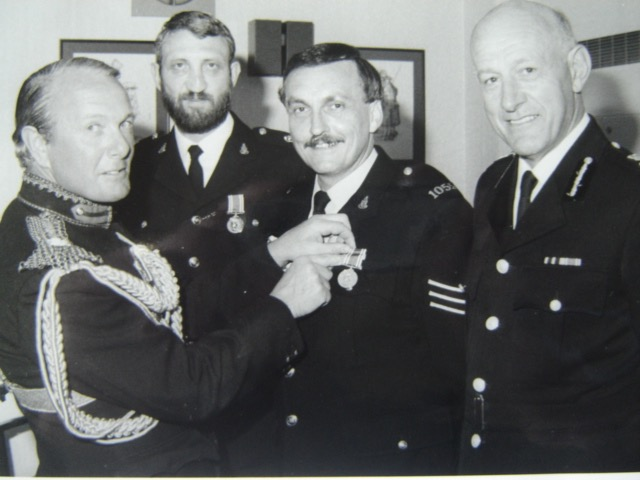 Police Long Service and Good Conduct medal presentation. High Sheriff presenting medal to Sergeant John Davies 1055 and Inspector Wayne Freeth-Selway 1056 with Chief Constable Albert Pacey.