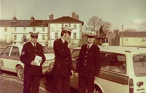 Traffic Sergeant Dave Iliffe (Ford Consul GT) meets Gloucester City Traffic Car (Volvo 145 Estate) (Call Sign Whiskey1), Constables Martin Sullivan and John Kennedy at Westend (Over Bridge), Gloucester in 1977. (Gloucestershire Police Archives URN 8547) | Photograph from Martin Sullivan
