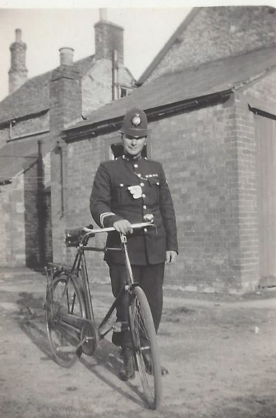 Harry Creed and bicycle before 1928 as that was when he was promoted to Sergeant. (Gloucestershire Police Archives URN 8934-1)