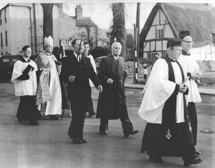 Procession on Albert Road Cheltenham between 1953 and 1956. Bishop of Tewkesbury Basil Guy flanked by Mr Walker to his left unknown on his right. Mr Shaw in centre left and ex Special Sergeant Edward (Ted) Preece on centre right right. At front left Canon Henson and right Canon Kent. Thought to be on the occasion of the dedication of the new vicarage in Prestbury. Ted Preece was a sidesman in St Mary's Church. (Gloucestershire Police Archives URN 8947) | From Geoff North