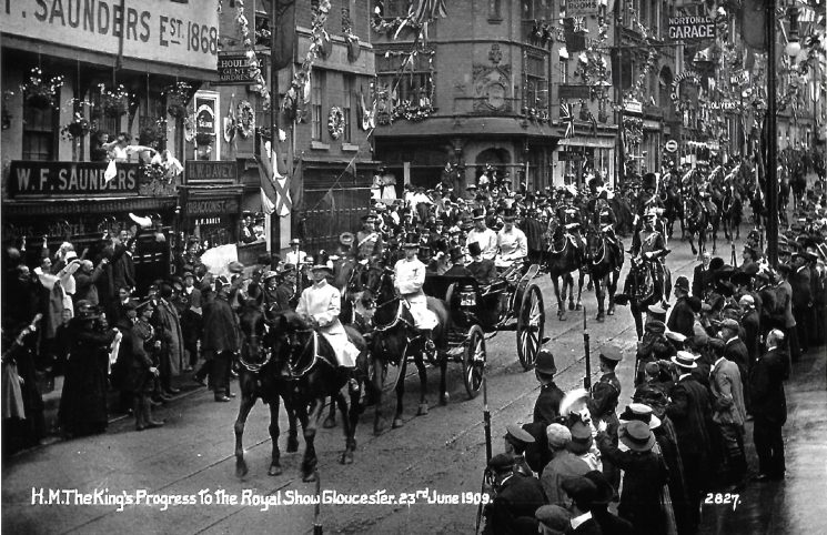 The Kings progress to The Royal Show Gloucester 23rd June 1909. police officers and soldiers seen lining the streets with the crowd behind them. Thought to be by 65 Northgate Street. (Gloucestershire Police Archives URN 9420)