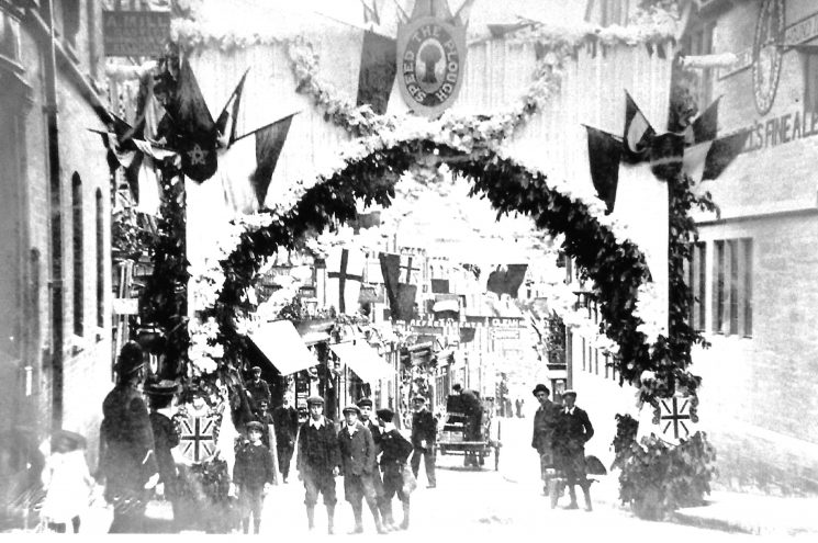 Police Officer standing in Gloucester Street Stroud decorated for the Agricultural show  June 1907. (Gloucestershire Police Archives URN 9423)