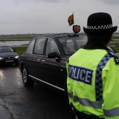 The Queen drives past in the rain. (Gloucestershire Police Archives URN 9769)
