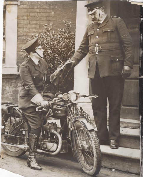 Woman Police Constable Janet Gray on her motorcycle receiving instructions from Superintendent Shellswell at Lydney Police Station. Janet Gray served in Gloucestershire Constabulary between 1929 and 1931. (Gloucestershire Police Archives URN 9895)