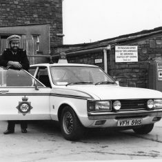 1978 saw the various Traffic bases in Gloucestershire closed down, as the department was centralised at Bamfurlong, near Cheltenham, at Junction 11 of the M5. Police Constable  John Bryant with a 3-litre Ford. (Gloucestershire Police Archives 10023) | Photograph from John Bryant