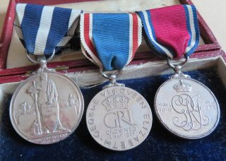 Group of medals belonging to Deputy Chief Constable JWP Goulder Jubilee medal, 1935 Coronation Medal 1937 Kings Police Medal (Gloucestershire Police Archives 10042-1)