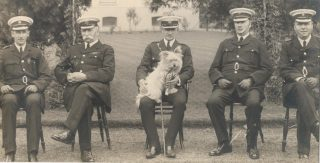Superintendent  A. Sainsbury;  Deputy Chief Constable  A. W. Hopkins;  Chief Constable Maj. F. L. Stanley-Clarke OBE;  Chief Superintendent  R. H. Hopkins;  Superintendent J. W. P. Goulder. This would have been before 1931 which was when  Deputy Chief Constable Hopkins retired. (Gloucestershire Police Archives 1212)