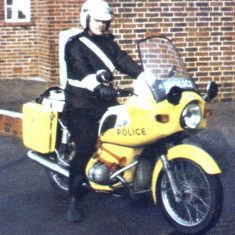 According to an ex main road motorcyclist it's not a Gloucestershire motorcycle. This is a BMW R75/6, of which Gloucestershire Constabulary had four. We didn't have that (awful) livery, we didn't have those blue lights, the air horns, or those Craven make panniers. (Gloucestershire Police Archives URN 10309)