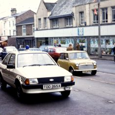 Ford escort with chequered band 1981. (Gloucestershire Police Archives URN 10339)