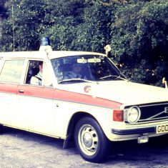 Volvo 145 estate patrol car on the A40 at Hazleton Pike. Police Constable Martin Cordwell driving, with Police Constable Hamish Pirie as observer.  1972. (Gloucestershire Police Archives URN 10371)