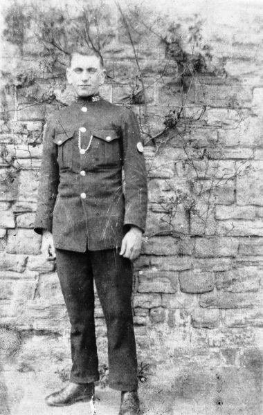 Police Constable Sydney Dobbs.Back of photograph says, Pop on Strike duty Lydney spring and summer 6 weeks very warm 1921 6 months service 13/12/20 19 years and 6 months. (Gloucestershire Police Archives URN 10471)