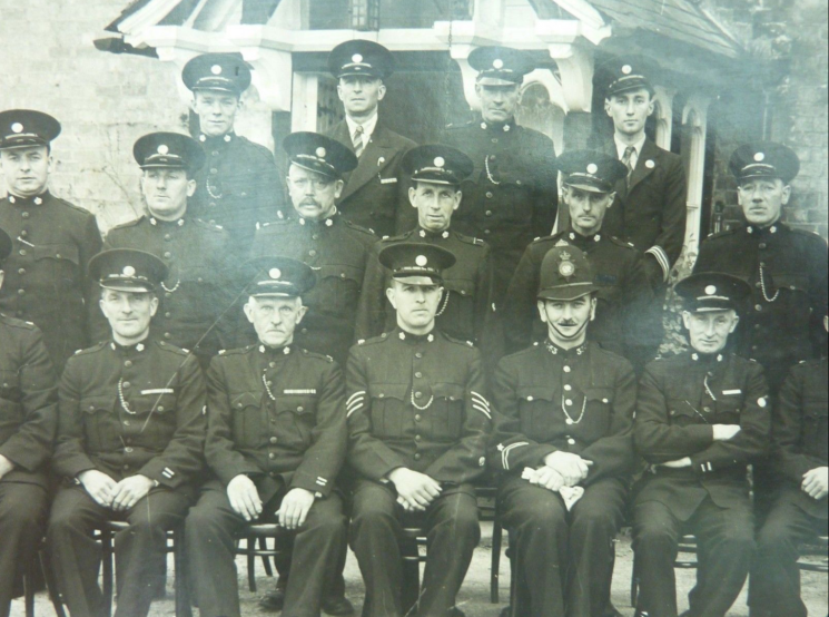 Special Constables  during World War II. Police Constable Sydney Dobbs seated in front row.(Gloucestershire Police Archives URN 8171)