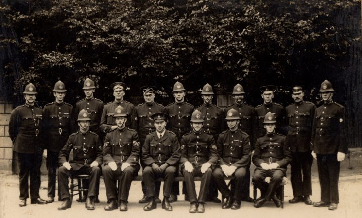 From the Collar numbers read the officers are thought to be. Back row from left; 175 William Moss, 143 Fitzroy Frederick Taylor, 299 Walter Lee, 289 Charlie Holmes, 158 Horace Winstone, 4 Walter Fry, 215 Walter Williams, 18 William Fry, 201 Harold Morgan, 276 Victor Isaac James 372 Oliver Mince. Front row from left; 20 Stanley Keyse, 235 Herbert Newman, 216 Percy Swaffield, 351 Edgar Carew, 353 Sydney Dobbs. (Gloucestershire Police Archives URN 8972)