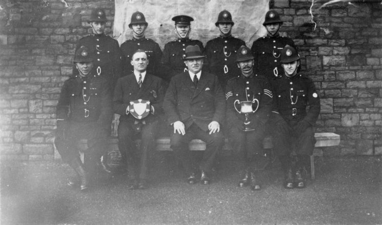 Officers with shield and trophy at Staple Hill. (Gloucestershire Police Archives URN 10451) | Photograph from Ray Ricketts