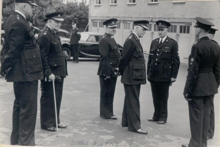 Her Majesty's Inspectorate of Constabulary . Inspection at Staple Hill 1953. Deputy Chief Constable A.H. Carter;  Chief Constable Colonel Henn; Superintendent J. Hallam; Her Majestys Inspector; Inspector H. D. J. Smith; (Gloucestershire Police Archives URN 149)
