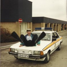 Police Constable Simon Mills on the bonnet of the car at Bamfurlong the day after the incident.(Gloucestershire Police Archives URN 10511-8)