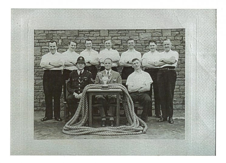Back row left to right D West, unknown, D Button, unknown, C Willetts, H Gould, Richard (Dick) Tibbots. Front row left to right Edgar Day, Superintendent Statham, P Blake. (Gloucestershire Police Archives URN 608)