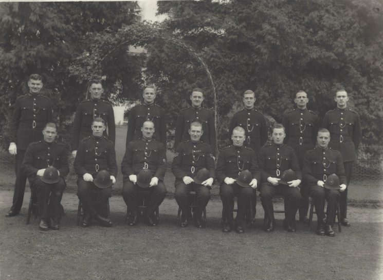 12 recruits and two instructors. These men were selected from 500 applicants. Starting pay 63/- a week plus free accommodation and medical and dental treatment. New recruits were never stationed in their home towns to avoid favouritism by or to people known to them Back row from left 43 Newman, 62 Tombs, 401 Batstone, 64 Tibbots, 106 Davey, 171 Neave, 251 Packer. Front row 92 Franklin, 434 Attwood, Instructor 414 Squire?, Instructor 109 Willmott?, 10 Turner, 372 Baker, 313 Brown. (Gloucestershire Police Archives URN 10230)