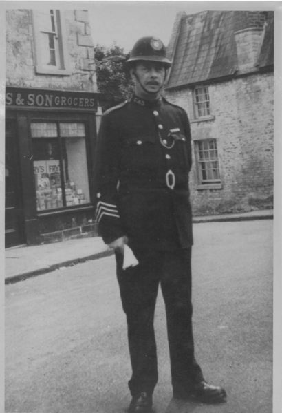 Sergeant Henry Wilcox in 1920s Marshfield High Street. He is standing on the now site of the war memorial. The police station was then at 123 High Street and was manned by a Sergeant and 2 Constables until 1956 when it closed and a new one man station was built. (Gloucestershire Police Archives URN 10684) | Photograph from Wendy Hope