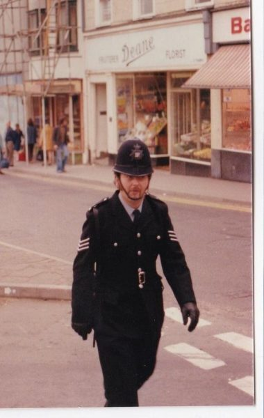 Sergeant Ricky Coleclough. Ricky is photographed on foot patrol in Dursley where he was a sergeant from the early 1980s until he retired. Before he was promoted he had been on traffic. He was an adventurer and a very keen cricketer. (Gloucestershire Police Archives URN 10699) | Photograph from Eric Moore