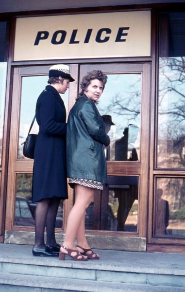 "Early 1970s when the uniform for Women Police Constables changed. This is Sue Dawkins (then Sue Wakefield) bringing in a prisoner through the front door. The ""prisoner"" was a member of the typing pool. (Gloucestershire Police Archives URN 10728) 